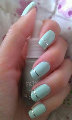 Mint green nail polish and silver stripes..