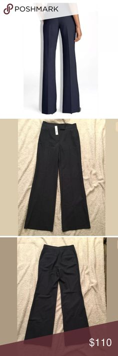 """NWT Theory Lucas B Tailor Pants, Deep Navy C/D NWT Theory Lucas B Tailor Pants, Deep Navy C/D, Size 6, Retail $240  Lightweight stretch, unlined wide leg pants. 96% wool, 4% lycra.  14.5"""" waist 9.5"""" inseam 18"""" hips 33"""" inseam 11.5"""" cuffed leg opening   Pet and smoke-free home. Theory Pants Trousers"""