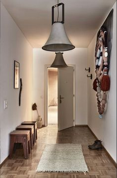 For the entry, Alexandrine commissioned Ukrainian craftswoman Oksana Levchenya to create a monumental sculpture made of socks. #dwell #rentalrevamp #renovation #moderndesign Modern Hallway, Hallway Decorating, Prefab, Modern House Design, Innovation Design, House Tours, Design Projects, Home And Family, Wall Lights