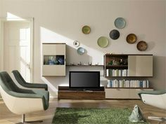 Sectional wall-mounted wooden TV wall system Tameta Collection by Hülsta-Werke Hüls