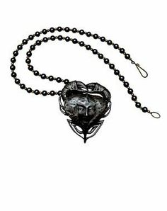 Pirates of the Carribean Tia Dalma Necklace by Master Replicas. $3.99. Give yourself or your true love a tender reminder to keep close to the heart. Celebrate your love with Tia Dalma's necklace!  Tia Dalma's necklace features a pendant with a crab's heart-shaped body, and a woman's face depicted on the front.  This romantic symbol of love is now available as an authentic replica from Master Replicas.  You'll love its timeless, romantic style - because love never...