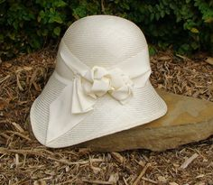 Ivory assymetrical cloche with Knotted ribbon trim.  Beautiful style!