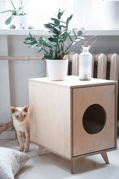 Scandinavian pet furniture - pet house / litter tray cover from Black Velvet.
