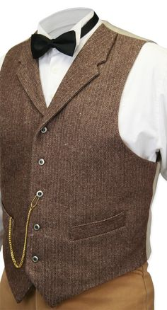 For the professor, our Walden Wool Tweed Vest in Brown Herringbone scored high honors as an impeccable credential on his academic record. Handsomely constructed and habdashered with five pewter buttons up the front, this late 19th to early 20th century inspired waistcoat is simply genius. A pointed-front hem, notched lapels and two pockets inset on a slant add more era-specific detail to this fine piece of gentlemen's clothing. Adjustable back for a precise fit.Front made from 100% wool…