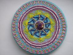 Buttonhole Stitch Mandala (source: http://ellascraftcreations.blogspot.com/2012/01/t-s-t-bead-mandala-2.html)