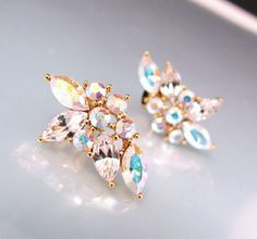 White AB crystal rhinestone flower post earrings  by DesignByKara, $24.00