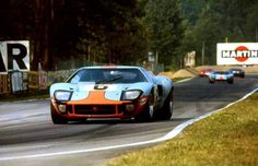 Formula 1 star Jacky Ickx & Jackie Oliver piloting their Gulf Ford GT40 to victory at the 1969 24 Hours of Le Mans.