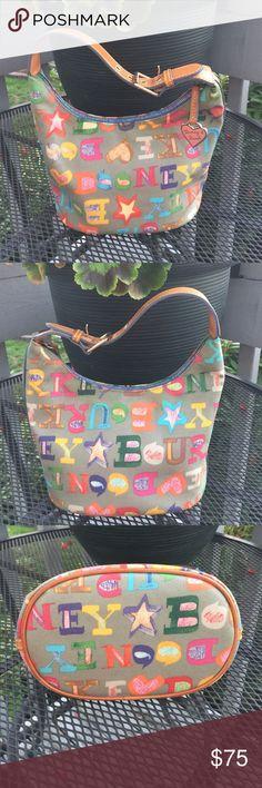 Dooney&Bourke vintage small bucket shoulder bag Adorable & great vintage condition! Nice leather adjustable strap. Dooney & Bourke Bags Shoulder Bags