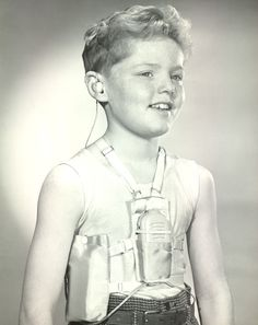 Boy model wearing body aid hearing device and underarm battery harness abt Gosh those things must've been the worst Deaf Culture, Old Advertisements, Vintage Medical, American Sign Language, Boy Models, Medical History, Hearing Aids, Speech And Language, The Past