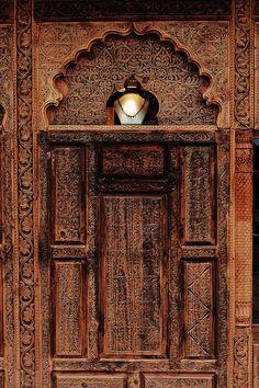 Hand carved door. Lok Virsa Folk Heritage Festival, Pakistan // Shaukat Niazi