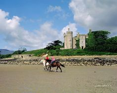 Riding horses on the beach at Clew Bay, Rosturk Castle, Ireland (County Mayo)