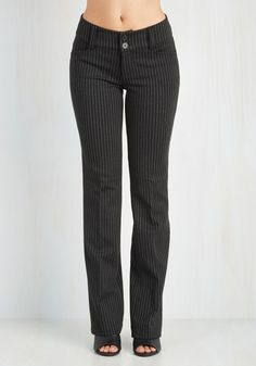 Pinstripe Perfectionist Pants. For a look that reaches the peak of profesh refinement, these black slacks are the perfect pair for the job. #black #modcloth