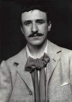 Charles Rennie Mackintosh, c. 1900, in his early thirties. This handsome Scot was responsible for some of the most beautiful design of the Arts & Crafts movement in the UK. His artistic temperament can be seen in the devil-may-care tying of his cravat. Submitted by thenewmessiah