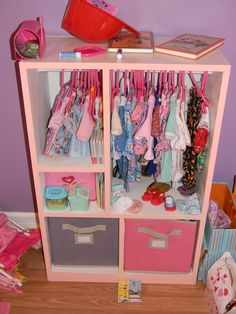 The wardrobe fully loaded with bitty baby clothes
