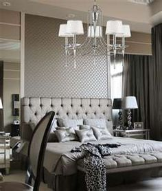 Master bedroom. Love the mirrors on the sides behind the nightstands to give the illusion of depth.
