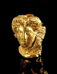 Female head made of gold foil depicting Io, the daughter of the river god Inachus. Hellenistic, End of 4th - early 3rd century B.C.