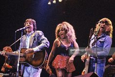 paul mccartney tina turner and rick parfitt performing on stage