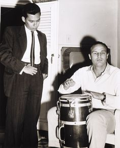 Anonymous, Marlon Brando plays the congas while Cuban novelist Guillermo Cabrera Infante looks on, 1956