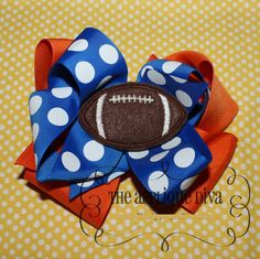 Hey, I found this really awesome Etsy listing at http://www.etsy.com/listing/107153431/football-hair-bow-center-embroidery