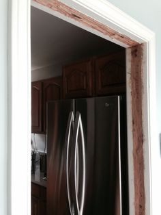 Today's project #1: fix the door frame amended to fit the new fridge.