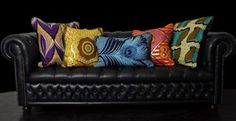 African print scatter cushions looking good against a studded black leather couch  Image source: www.africanprintinfashion.com