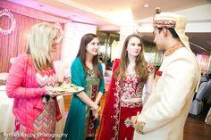 Bride and Groom enjoying their wedding celebration. http://www.maharaniweddings.com/gallery/photo/107160