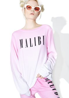 "Wildfox Couture Malibu Baggy Beach Jumper fer when yer dreamin' of some serious beach time, babe. Chill out in this cozy sweater that features a soft pink to white faded construction, round neckline, long sleeves, and black ""Malibu"" text across yer chest."