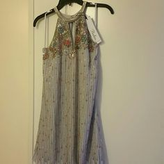 Parker Sansa Beaded Georgette Party Dress sz S NWT Parker Sansa Beaded Georgette Party Dress.  STYLE #: PA5031525FSP Shell: 100% silk, Lining: 10% polyester   Purchased from Nordstrom. All tags and beads attached. In perfect condition. Absolutely beautiful detailed beading. Parker Dresses Midi
