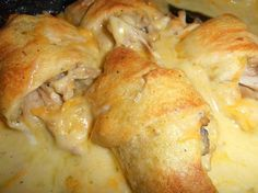 Mamas Chicken Roll Ups 2 large chicken breast 1 can crescent rolls 1 10.5 oz. can cream of chicken soup 1/2 soup can of broth (use what the chicken cooked in) 1/2 soup can milk 1 T. all purpose flour 6 oz. shredded sharp cheddar cheese pinch of salt and pepper