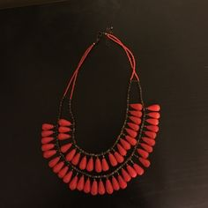 Beaded adjustable orange/red statement necklace Adjustable statement necklace from Francesca's. Orange. Worn 2x Francesca's Collections Jewelry Necklaces
