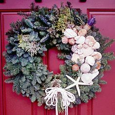 14 Ideas for Festive Wreaths | Bold  Spruce up a fir wreath with coastal character by adorning it with seashells and fishing lures. Hung on a broad red front door, the seasonal accent warmly welcomes all guests. Wreath available at home supply stores.