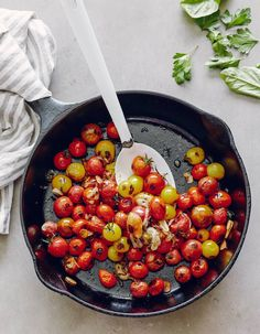 absolutely gorgeous Blistered Cherry Tomatoes picture.  Clean, crisp, vibrant colors via @whatsgabycookin
