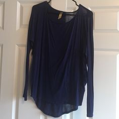 Navy blue long sleeve shirt Navy blue long sleeve shirt. A bit longer in the back than it is in the front. Worn a few times, no wear or damage. Francesca's Collections Tops Tees - Long Sleeve