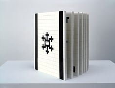"""LEGO book by Christian Bok    Ten Maps of Sardonic Wit is also """"bookish artware""""—in this case, a codex, whose cover, spine, pages, and words consist of nothing but thousands of LEGO bricks, each one no bigger than a flat tile, four pegs in size."""