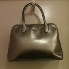"Matte silver handbag Leather, protective feet on bottom. Double handle drop about 6"". Double zip closure. About 13"" at widest across bottom. Just over 8"" in height. NWOT. Perlina Bags"