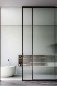 Floor to ceiling sliding doors fitted with a textured ribbed glass which lets the natural light filter through and a bit more privacy. #glassslidingdoors #texturedglassslidingdoor #ribbedglassslidingdoor #slidingdoors #slidingdoorsinternal #slidingdoorsinterior #slidingdoordesignideas #slidingdoordesigninterior