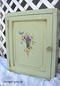 antique wooden cabinet with traditional French basket floral painting,original vintage minty green paint.  by 4WitsEnd, via Etsy  SOLD