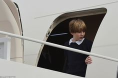Heading out: Barron appeared a bit uncertain at first as he made his way off the plane ahead of everyone on Thursday