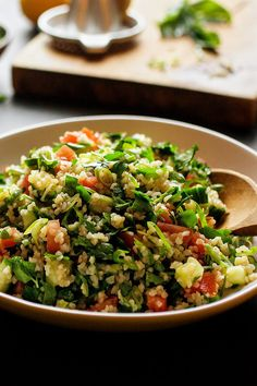 In this tabbouleh recipe, I treat green garlic stems like herbs, and mince them into a mix of parsley and mint that make up the backbone of the salad. (Photo: Andrew Scrivani for The New York Times)