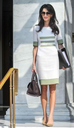 Amal stepped out with a new outfit, and last name! Mrs. Clooney headed back for to work on Oct. 14, 2014 in Greece, since marrying George Clooney in Italy. The petit human rights lawyer officially took her hunky husband's last name, making the change on her London-based law firm website.