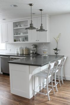 Wood floors with white kitchen peninsula