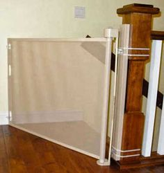 The retractable safety gate or baby gate can even be installed on an angle as shown here