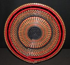 """Beautiful black and red bowl measuring 12"""" in diameter and 3"""" deep. Black and red stitching embellished with black glass beads.Southern Pines Basket spb087 GALLERY PIECE - CLICK FOR MORE INFO"""
