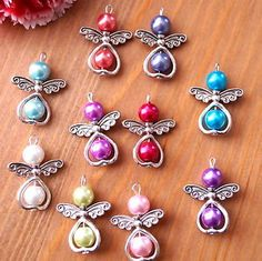 10 or 20 Mixed Angel Charms Pendant Metal Heart Pearl Beads Silver Wings Christmas Stocking Filler Tree DecorationSet of 6 handmade Angel Fairy charms. Beaded Crafts, Beaded Ornaments, Jewelry Crafts, Beads And Wire, Pearl Beads, Beaded Jewelry, Handmade Jewelry, Jewellery, Charm Jewelry