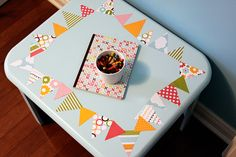 diy kids table she picked up from goodwill and painted and modge podged. so cute!
