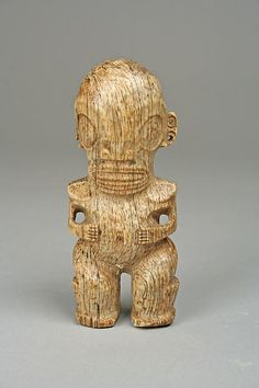 Male Figure (Tiki) Date: late 19th–mid-20th century Geography: Marquesas Islands Culture: Marquesan (Enata) people Medium: Whalebone Dimensions: H. 4 1/2 x W. 1 7/8 x D. 1 1/4 in. (11.4 x 4.8 x 3.2 cm) Classification: Bone/Ivory-Sculpture Credit Line: The Michael C. Rockefeller Memorial Collection, Gift of Nelson A. Rockefeller, 1969 Accession Number: 1978.412.827 Not on view