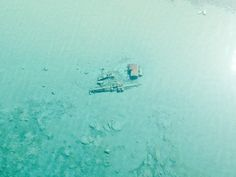 Lake Michigan Is So Clear Right Now Its Shipwrecks Are Visible From the Air  A Coast Guard patrol spotted the wrecks in shallow waters that are only clear after the lake's ice melts and before summer sediment swirls and algae blooms