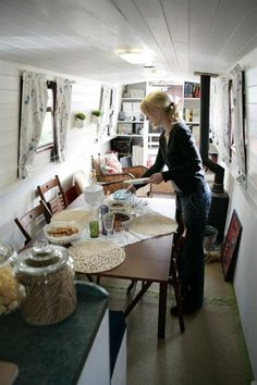 Ikea family: Life on a houseboat - It may look tiny but we've had eight for dinner – we've managed this by using full-sized furniture that folds down.