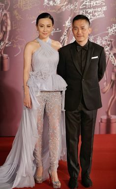 "Hong Kong actor Tony Leung, nominated for Best Actor for his role in ""The Grandmaster"", poses with his wife, actress Carina Lau, on the red carpet during the 33rd Hong Kong Film Awards in Hong Kong April 13, 2014"