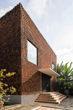 The practice decided to construct most of Wall House's exterior using perforated square bricks that allow fresh air and natural light to seep in from the outdoors.